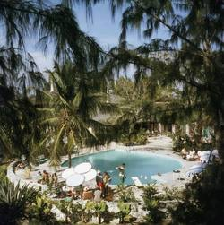 Buy Slim Aarons 'Eleuthera Pool Party' photographic print in NZ New Zealand.